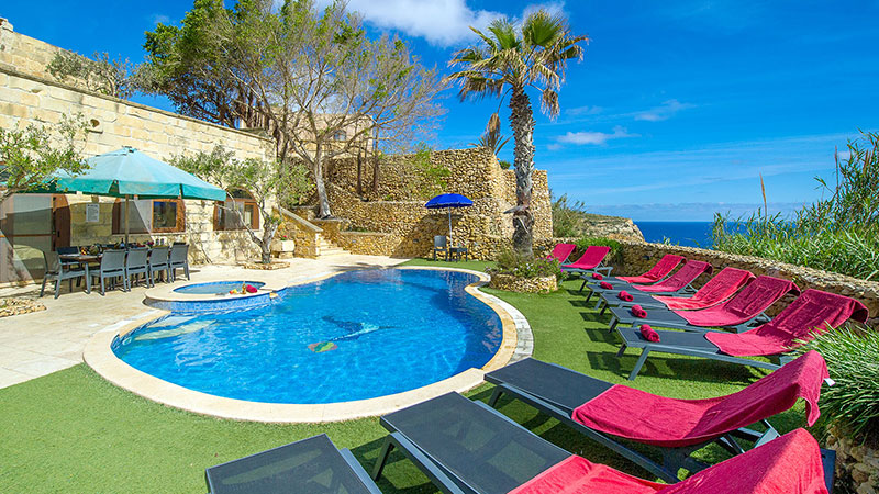 Image of villas pool, sun beds and sea view